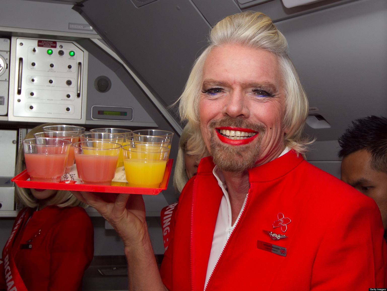 Richard Branson as a stewardess on Virgin Australia at www.lyricmarketing.com